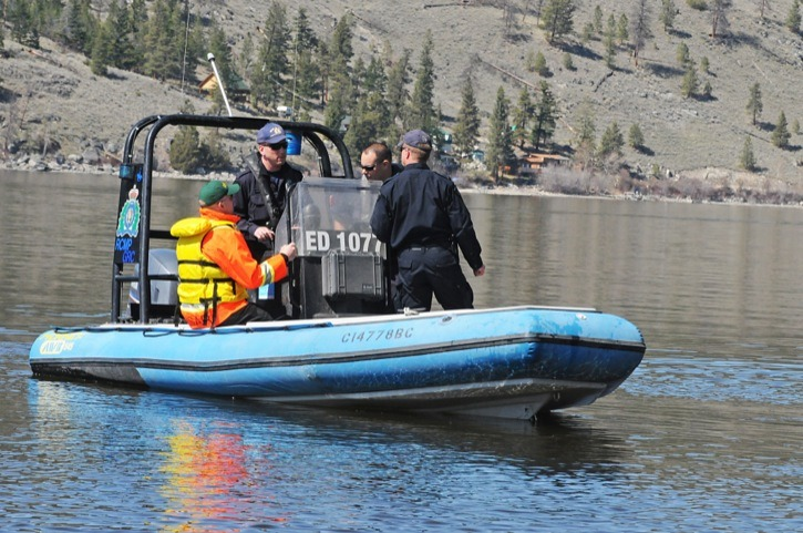 Members of the RCMP dive team search the waters of Nicola Lake on Monday afternoon for any trace of two Langley teens, who went missing Sunday. An overturned canoe was found Monday morning, prompting the call for the dive team.