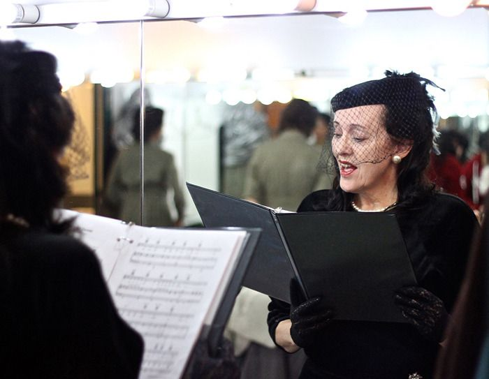 """Elizabeth MacPherson takes a moment to rehearse before stepping onto the Chief Sepass Theatre stage. MacPherson performed songs of Britain's Vera Lynn as part of """"Until Everyone Comes Home"""" a Second World War-era variety show held Saturday in Fort Langley."""