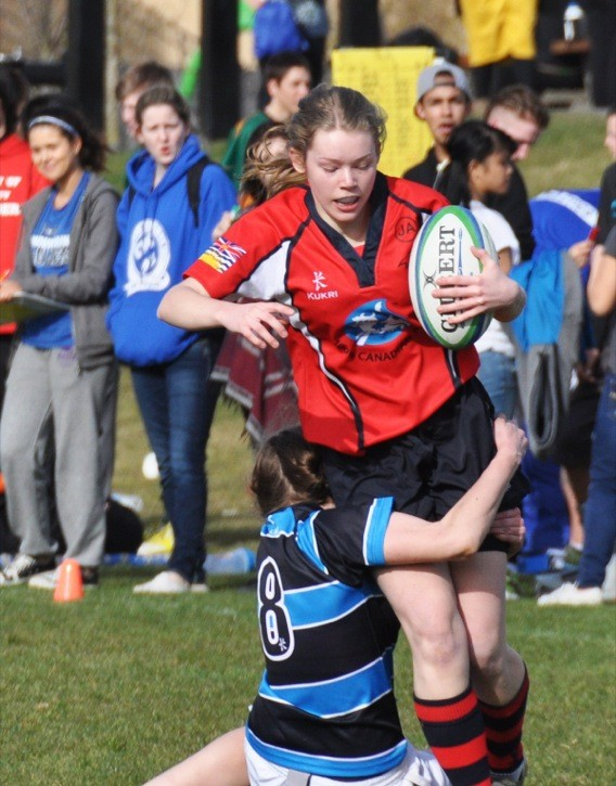 Local high schools hit the field for the Langley Sevens Rugby Tournament on March 13 at R.E. Mountain Secondary School. Aldergrove Totems' Cheye Gustafson grabs hold of D.W. Poppy Redhawks' Jenna Richmond in senior girls action. Below: D.W. Poppy's Wes Foss sprints away from the competition during senior boys rugby; Brookswood Bobcats' Hector Herr is tackled by Langley Saints' Nathan Warren during junior boys action; D.W. Poppy's Dawson Calfa tries to break free of MOuntain Eagles' Joseph Kim; D.W. Poppy's George Brown in Grade 8 action against the H.D. Stafford Skyhawks; and D.W. Poppy's Gabe Anderson tries to break free from a pile of H.D. Stafford tacklers during Grade 8 boys action.