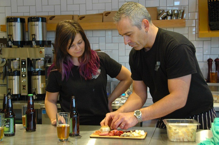 Executive chef Stephan Schigas test-plates a charcuterie of local meats and cheeses alongside Lelem' employee Leanne Richardson. The new arts and cultural cafe opens this Saturday (Dec. 7) on Fort Langley's historic riverfront.