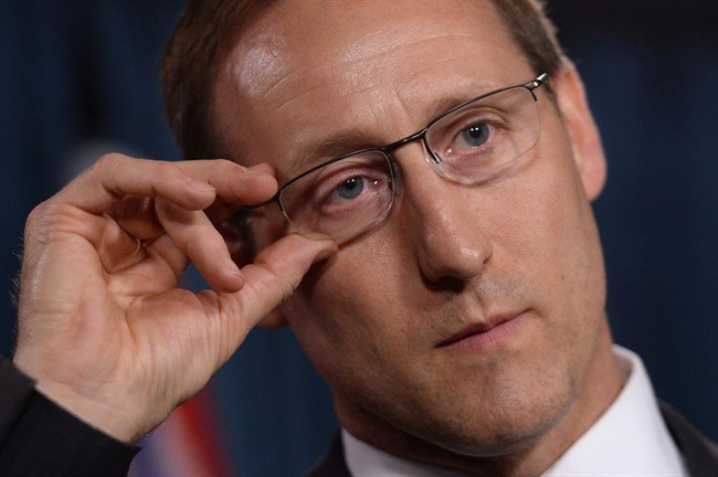 Justice Minister Peter MacKay addresses a news conference on Parliament Hill in Ottawa on Wednesday, June 4, 2014. The Conservative government has introduced legislation to criminalize the purchase of sexual services.THE CANADIAN PRESS/Sean Kilpatrick