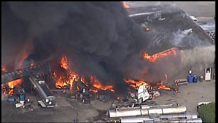 Trucks, trailers and a large building are on fire at a massive fire in the Port Kells industrial area, which broke out Tuesday afternoon.