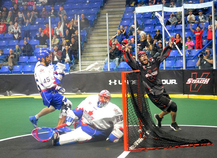 Vancouver Stealth's Peter McFetridge celebrates his first quarter goal against Toronto Rock goaltender Nick Rose on Saturday at the Langley Events Centre. The Stealth are on the road this weekend but fans can follow the action via Twitter as the Stealth are part of the NLL Game of the Week.
