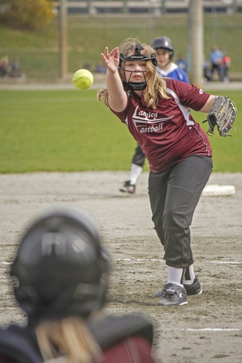 Jamie Marson of the Galaxy Girls fires a pitch during her U12 team's game on the opening day of the Langley Fastball season on April 6 at Noel Booth Park.