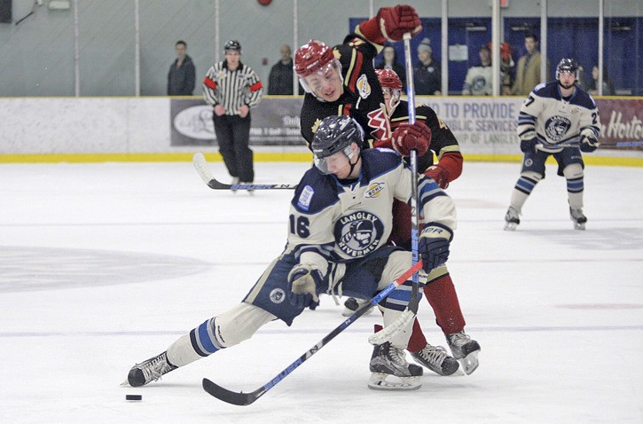 Eric Butte of the Langley Rivermen tangles with a Chilliwack Chief at The Lodge Saturday night. The Chiefs took the best-of-seven series with a 3-1 win.