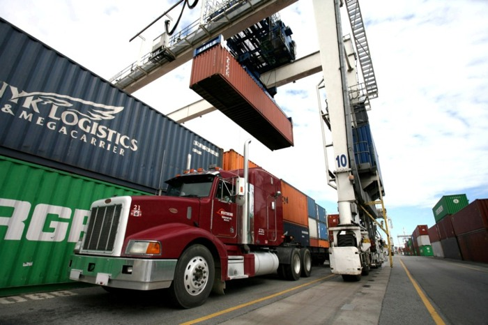 A container is loaded onto a truck at Deltaport. Business groups have entered the debate on how to refinance TransLink, saying transit service must be maintained and expanded to ensure goods movement isn't overwhelmed by congestion.