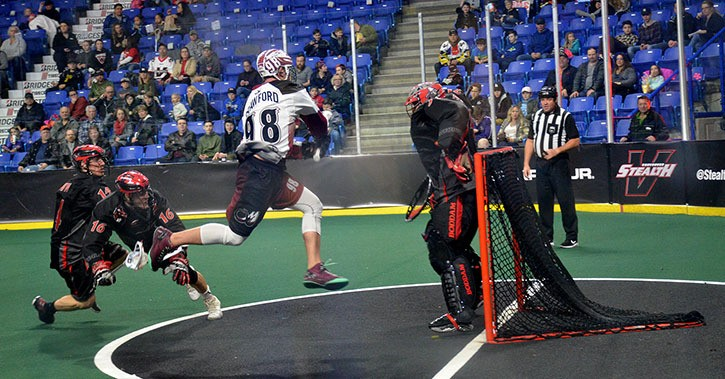 Vancouver Stealth's Tye Belanger denies Colorado Mammoth's Callum Crawford, one of 43 saves Belanger made in earning first star honours. The Stealth lost 10-9 in overtime to the visiting Mammoth at the Langley Events Centre on Sunday night in National Lacrosse League action.