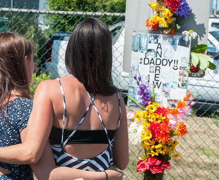 One of Andrew Leduc's sisters, Michelle Leduc-Sahay, embraces one of the attendees at the Saturday, Aug. 9, memorial for her brother. Andrew was struck and killed by a semi on August 7, 2013, near the 19500 block of the Langley Bypass, where the event was held.