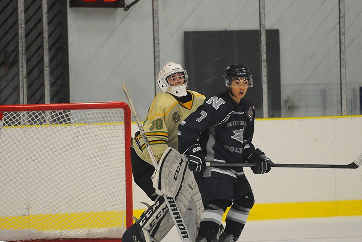 Langley Knights goaltender Jesse Gillis has to work around the screen set by North Vancouver Knights' Bayley Tsumura during the Knights' Pacific Junior Hockey League season opener last Thursday at the George Preston Recreation Centre. The Wolf Pack won the game 7-3. The Knights were also in action on Saturday against the Mission City Outlaws winning 4-3 in overtime. They play the Grandview Steelers tomorrrow (Thursday) night at the Preston Centre.