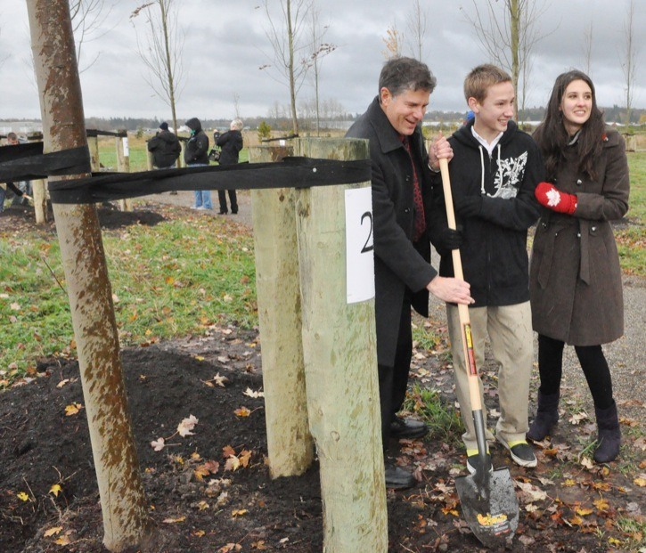 Michael and Elizabeth Pratt joined Langley MP Mark Warawa as he ceremonially plants the tree he donated. The Pratt siblings officially unveiled the Langley Youth for the Fallen: A Walk to Remember on Nov. 11. The project consists of a pathway of trees at the Derek Doubleday Arboretum dedicated to the 158 Canadian soldiers killed in Afghanistan. To become involved email langleyyouthforthefallen@gmail.com or visit the Langley Youth for the Fallen Facebook page.