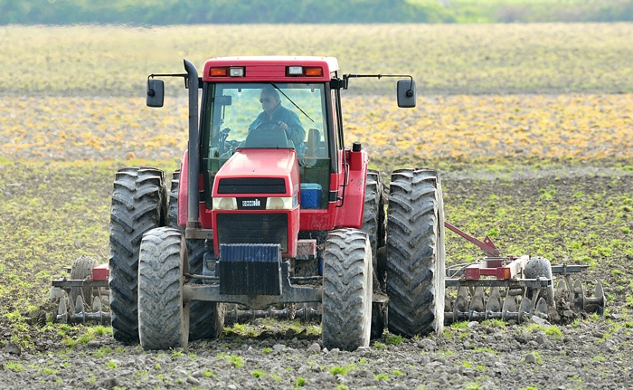 A farmer working agricultural land in Delta. B.C.'s top government watchdog has renewed his call for action to better protect farmland.