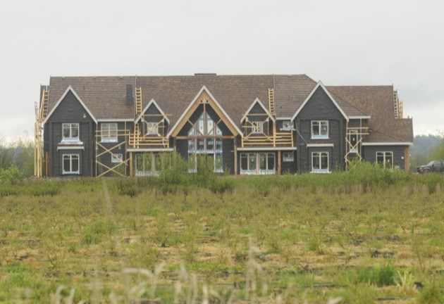A giant farm mansion while it was under construction in 2012 in Surrey.