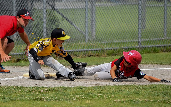 Langley Baseball's Mason Mandzuk tags out a member of the Highlands (North Vancouver) team during the nine-year-old Selects district championships at City Park on Saturday. Langley lost the game 10-9. The 12-team tournament wraps up on Sunday with the championship game at 4 p.m.