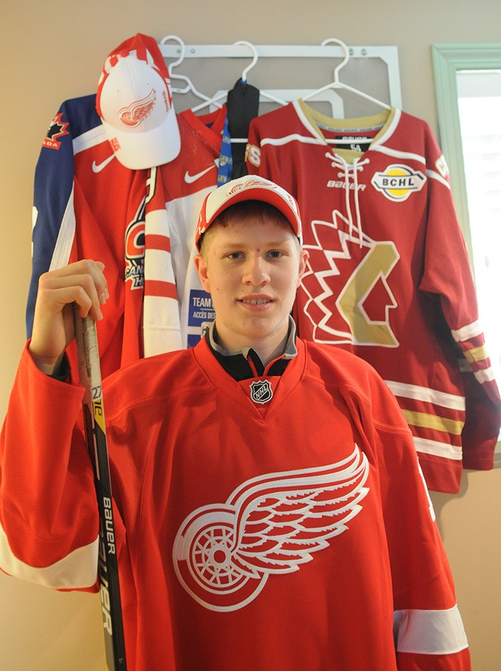 Walnut Grove's Dennis Cholowski, a member of the BCHL's Chilliwack Chiefs the past two seasons, models his new Detroit Red Wings jersey on Monday afternoon. The Wings selected the 18-year-old in the first round, 20th overall, of the NHL entry draft in Buffalo.