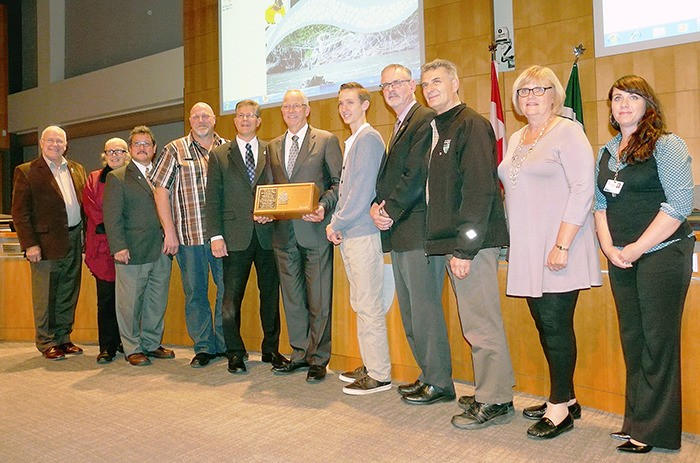 From left: Councillors Grant Ward, Kim Richter, Bob Long, David Davis, MP Mark Warawa, Mayor Jack Froese. Michael Pratt, and Councillors Charlie Fox, Steve Ferguson, Bev Dornan and Michelle Sparrow pose with a boxed flag that has flown from the Peace Tower in Ottawa. The flag was presented on Monday, Oct. 7