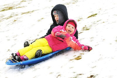 Six-year-old Max Pinchin and his sister Sarah, 3, enjoy sledding in Brookswood on Sunday after a late winter snowfall Saturday night blanketed Langley and the rest of the Lower Mainland. It was a very short-lived snowfall, as rain later in the day Sunday melted much of the snow. By Tuesday, there was very little left except for mounds in parking lots that had been cleared.
