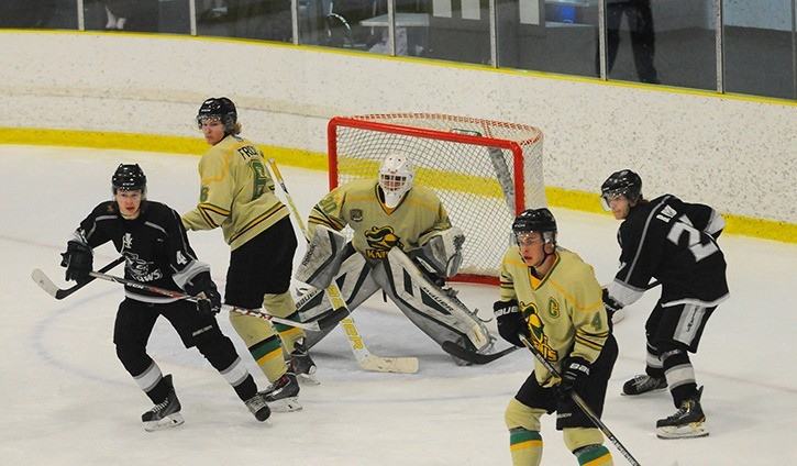 Langley Knights' Jacob Fricks (left) and captain Blake Gorrill try to keep Mission City's Justin Bowerman and Brody Dyck to the outside and out of the way of goaltender Nickolas Trenciansky during game two of the PJHL divisional semifinal series. The Knights won games one and two but the Outlaws evened the series with wins in games three and four.