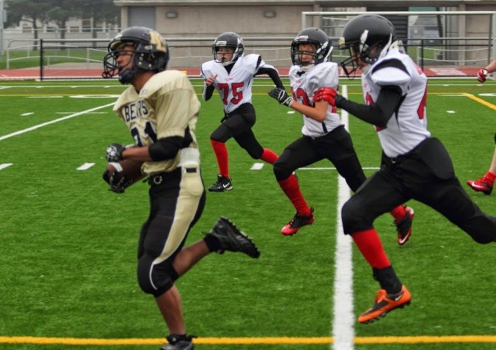 North Langley junior bantam Bears running back Pablo Wigwigan proved too much to handle for the Abbotsford Falcons, rushing for more than 300 yards and four touchdowns in his team's 26-22 victory.