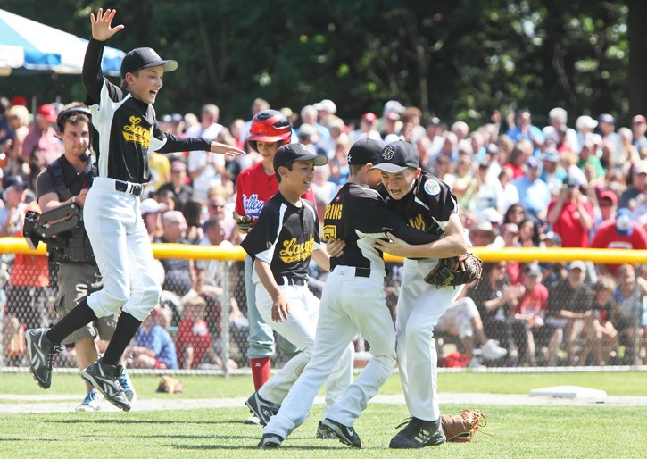 Langley All-Stars players celebrate their win against Valleyfield, Quebec in the final on Saturday. The new Canadian Little League champions are representing Canada at the Little League Baseball World Series in Williamsport, Pa. Their first game is on Friday against Saudi Arabia.