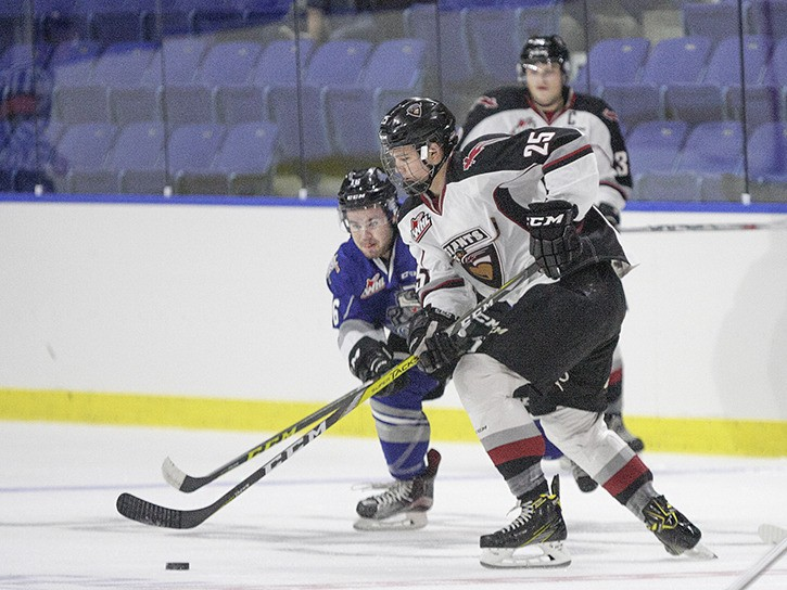 Vancouver Giants' defenceman Kaleb Bulych tries to skate past the check of Victoria Royals' Blake Bargar during the Royals 2-0 win on Saturday afternoon at the Langley Events Centre. The game was the final pre-season contest for the Giants who embark on their first season in Langley on Friday night when they welcome the Everett Silvertips to town. Puck drop is 7:30 p.m. The Giants will also honour the late Gordie Howe, whose family is part of the Giants ownership group, prior to the game, as well as wearing a special 'Mr. Hockey' jersey.