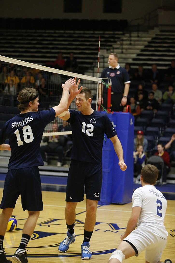 Trinity Western Spartans' Nick Del Bianco (#18) and Lucas Van Berkel (#12) are expected to lead the men's volleyball team this season. The Spartans open the season ranked third in the country.