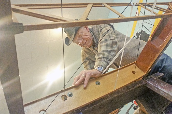Langley Canadian Museum of Flight volunteer John Jouan works on the wing of a classic Tiger Moth biplane undergoing restoration. The museum is planning a fundraising gala and auction for March 7. More information can be found at www.canadianflight.org.