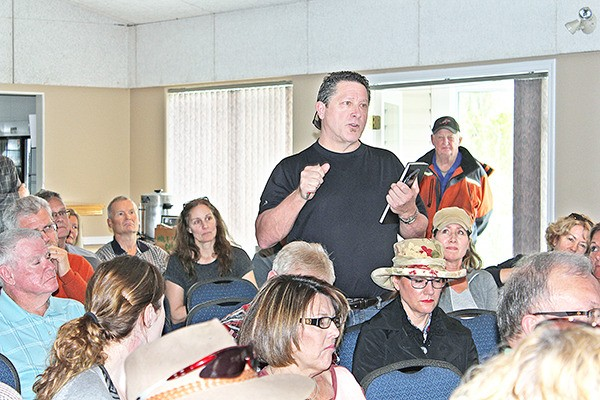 Surrey Coun. Mike Starchuk addresses a crowd at a community meeting in South Surrey Sunday hosted by opponents of a truck-park proposal. Below, former Surrey mayor Bob Bose speaks.