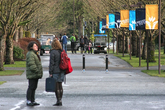 Trininty Western University sttudents chat on campus earlier this year.