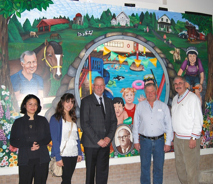 A mural celebrating Murrayville and marking W.C. Blair's 25th anniversary was unveiled by the young artists who created the work, Township of Langley Mayor Jack Froese, John Blair – son of former Mayor Bill Blair, whom the Recreation Centre was named after, and Don Shilton of the Langley Arts Council.