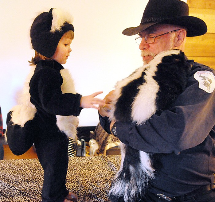 Anna Benabo, 2, meets the real-life inspiration for her costume, Febreze, a two-year-old skunk from Cinemazoo in Surrey. Febreze and her owner, Gary Oliver, entertained dozens of kids at the Fort Langley National Historic Site on the weekend as part of the Family Fright at the Fort halloween event.