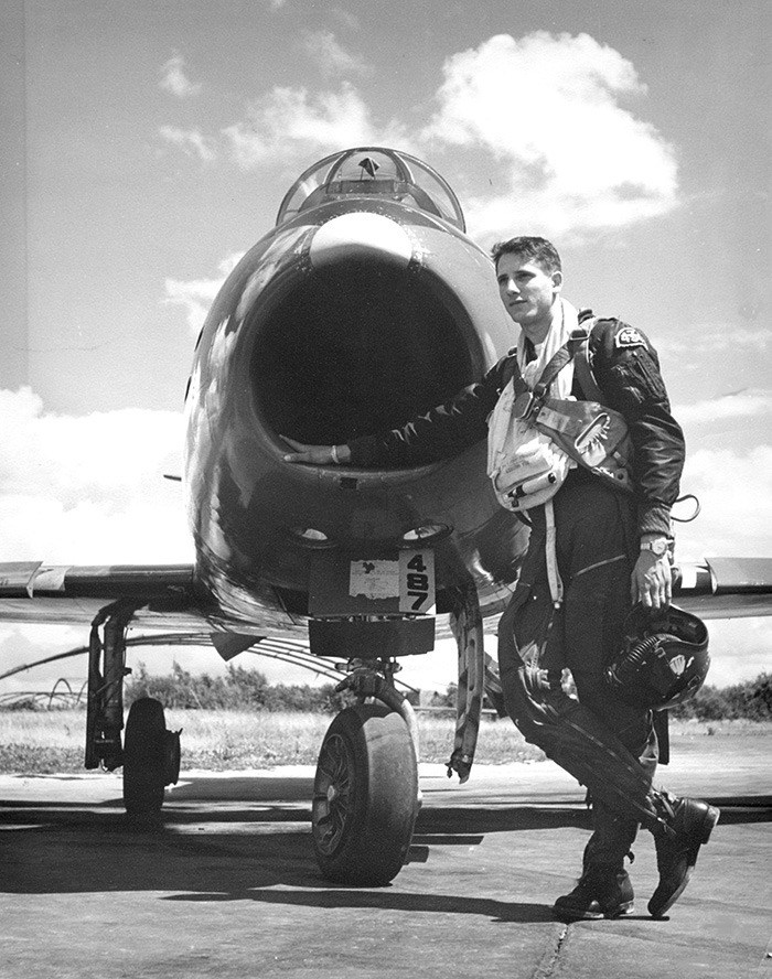 George Miller is shown as Flying Officer pilot of an F-86 Sabre jet while posted with RCAF 434 Squadron at Zweibrücken, West Germany in the 1950s; below: Miller was inducted into the Canadian Aviation Hall of Fame in Toronto on June 4.