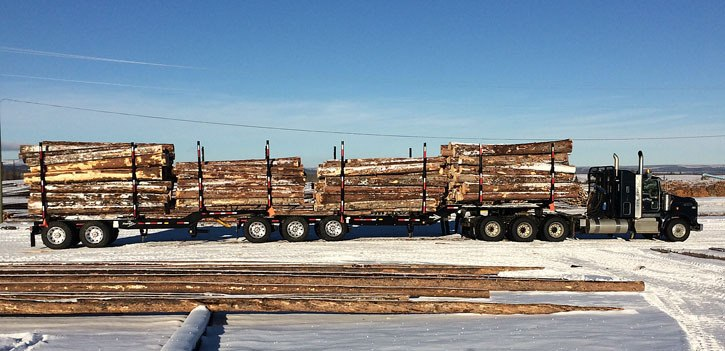 Nine-axle log trucks are hauling to Canfor's Vanderhoof sawmill, saving transportation costs and reducing greenhouse gas emissions.