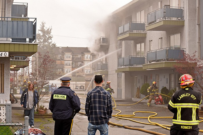 Firefighters worked to extinguish a blaze that broke out in an empty unit of a rental building on 201A Street in Langley City on March 23. The cause of the fire is a mystery, says the municipality's deputy chief.