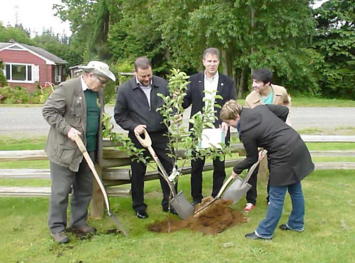 Langley's 2012 environmental heroes planted a tree in the historic Fort Langley orchard as part of the award ceremony last June. With MP Mark Warawa (centre) are left to right) Bob Puls, Natal Cicuto, Deven Azevedo and Heather Jenkins.