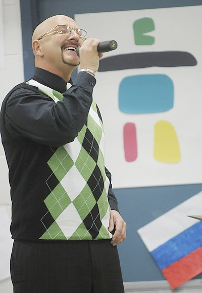 Gino Gerussi sings his original song, For Those Who Believe, during an Olympic assembly at Belmont Elementary School.