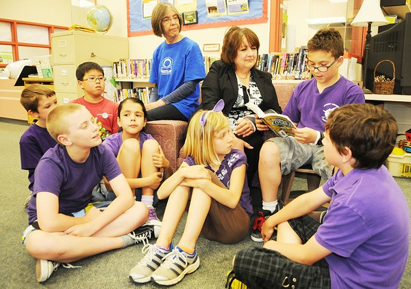Phoenix Crawford reads one of the selections which helped Gordon  Greenwood Elementary School to another Reading Link Challenge victory.  Listening are teacher librarian Lydia Gennai, Wiena Groenewold,  librarian at Walnut Grove Library, and students Hee Jun Yeom,  Colby Chambers, Melody Thomson, Kevin Wade, Amelie Rousseu, and Campbell Jennejohn.