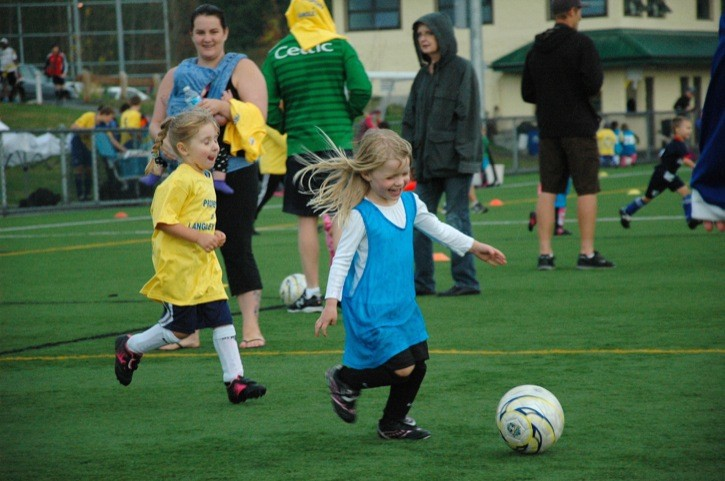 Brooklynn O'Hara, 4, breaks away with the ball past Payton Yarwood, 4, at the Langley United Soccer Association U5 boys and girls soccer jamboree. It was held on Sunday at Willoughby Community Park.
