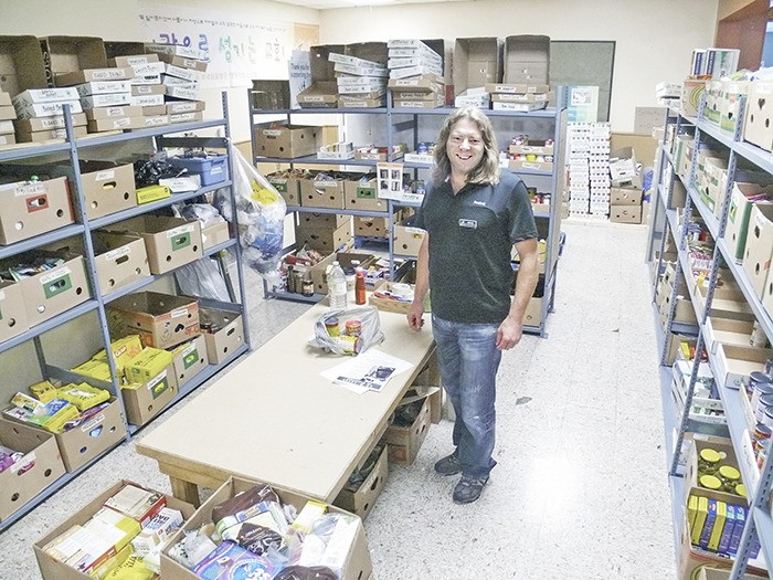 Bruce Strom of the newly-launched Sources Food Bank in Langley stands in the sorting room at the United Church on 200 Street and 56 Avenue. Sources, which has operated a food bank in White Rock for over 30 years, was invited to move into Langley by Food Banks BC after the local food bank left the association.
