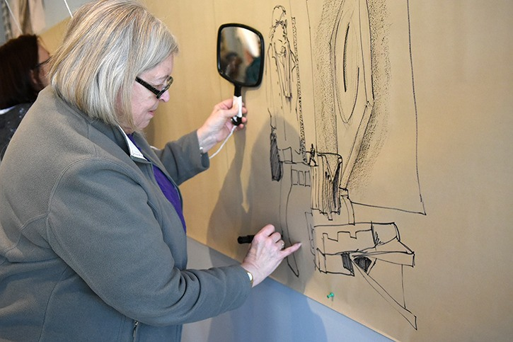 Kristin Krimmel was one of several artists to take part in a collaborative draw-in during the Fort Gallery's opening reception for 'Drawn to Draw' on March 19.