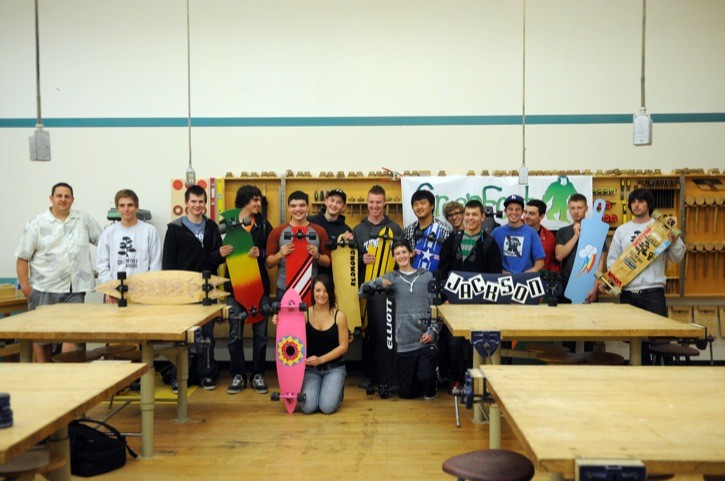 Students of Darren McKay's (far left) carpenty and joinery class at Walnut Grove Secondary, displayed the longboards they created over the past couple of months. The project was aided by GreenFoot Board's Jackson Hilts (far right) and Tyler Raffle (second from left).
