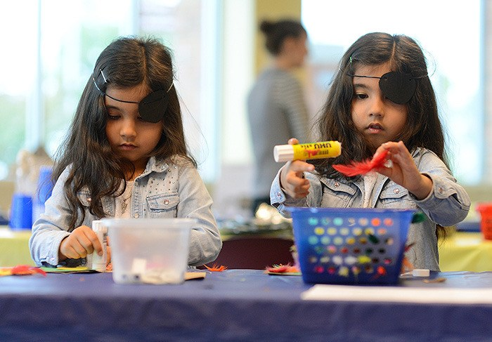 Twin sisters Sahara (left) and Zohal Jaghori, 6, from Langley, work on pirate-related crafts the Surrey Museum during International Talk Like a Pirate Day on Sept. 19.