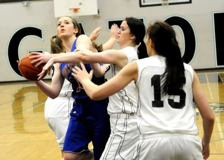 Brookswood Bobcats' Jessie Brown drives to the basket against the defence of Walnut Grove Gators' Janessa Neufeld and Cassidy Irwin during the Bobcats' 91-46 victory at Walnut Grove Secondary last week (Jan. 16).