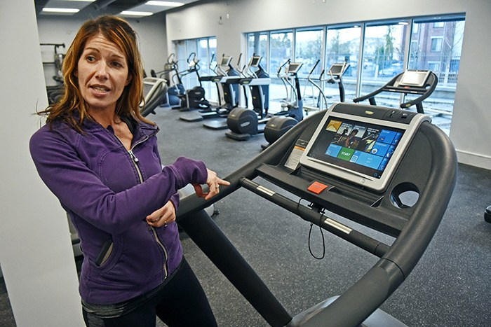Christine Daum, recreation supervisor for the City of Langley prepares to demonstrate one of the new Timms Community Centre's state-of-the-art cardio machines. The equipment, built by Italy's TechnoGym, is socially interactive meaning users can go online while they work out, compete with people on other machines or take a virtual tour of nearly any spot in the world as they work out. The centre will hold a grand opening on Wednesday, Feb. 24. The public is invited to drop by between 4 p.m. and 7 p.m. to tour the new facility and try out a complimentary fitness class or two.