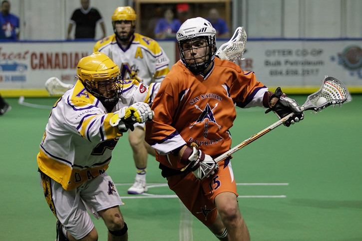 Six Nations Arrows Adam Bomberry-Davis fends off a Coquitlam Jr. Adanacs check during Minto Cup action at the Langley Events Centre over the weekend. Coquitlam won 7-6 and 11-6 to take a 2-0 series lead in the best-of-seven Canadian junior A championship series.