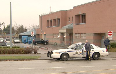 The Langley RCMP detachment was partially evacuated and the surrounding area blocked off after a black SUV (background) was towed there and found to have a suspicious package inside on Monday morning. It turned out to be safe.