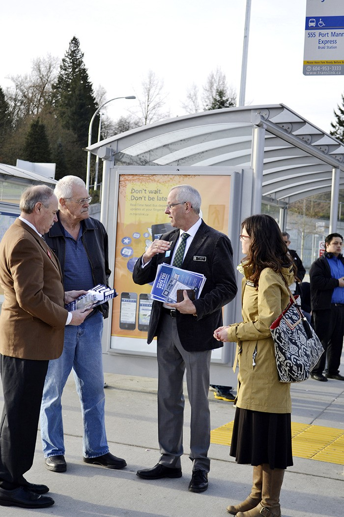 Langley Township mayor Jack Froese speaks with a concerned resident about the transit referendum at the Calvorth park-and-ride where Froese, along with City mayor Ted Schaffer and medical health officer Michelle Murti, spent Tuesday morning talking to transit users, promoting a 'yes' vote and handing out brochures in favour of a 0.5 per cent PST hike.