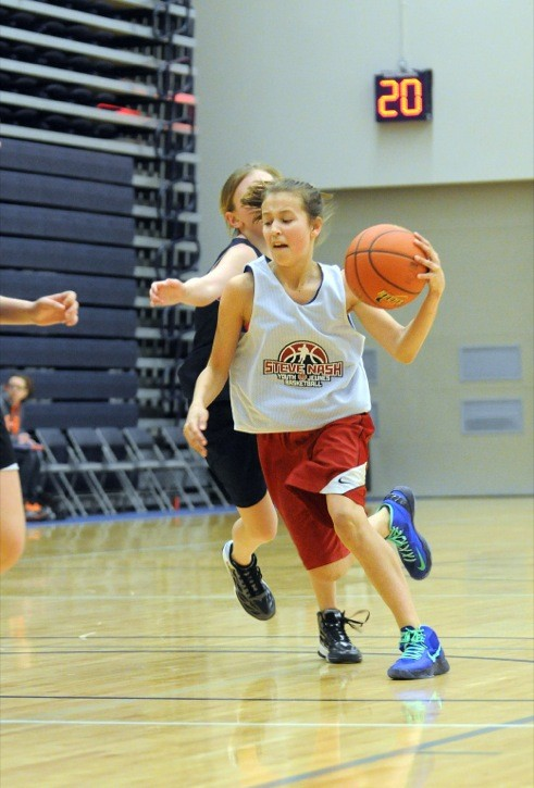North Langley Basketball Association's Janessa Knapp dribbles the ball up the court during the semifinals of the U13 girls competition against Richmond at the Steve Nash Challenge held at the Langley Events Centre over the weekend.