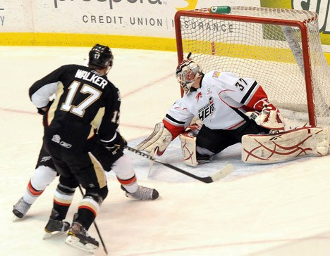 Geoff Walker of the Wilkes-Barre/Scranton Penguins rips a shot past Heat goalie Leland Irving to open the scoring on Friday evening at the Abbotsford Entertainment and Sports Centre.