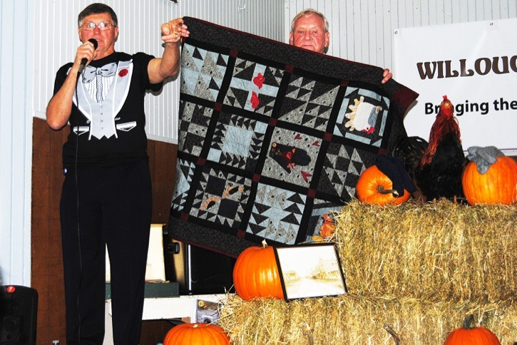 A highly successful fall harvest supper at Willoughby Community Hall ended with a spirited and at times hilarious auction. Auctioneer Arne Mykle sold a variety of items to benefit the hall, a mainstay in Willoughby since 1937. President Karl Dreise holds up a quilt made and donated by Caroline Monetta, which prompted some brisk bidding. The hall was packed to capacity Sunday night for the dinner, which was the 30th annual event.