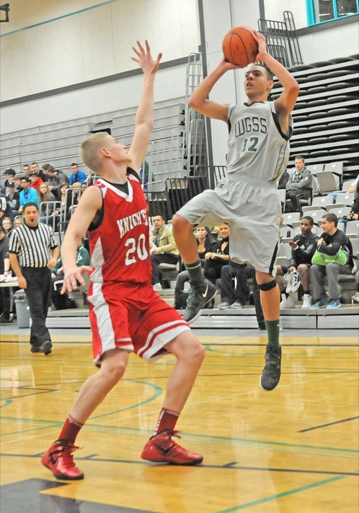 Walnut Grove's Jadon Cohee goes up for the shot against the defence of  St. Thomas More Collegiate's Andrew Morris on Dec.9 at WGSS during senior boys' second round action at the Gators' Candy Cane Classic. The Gators, who are 7-1 and are ranked eighth in B.C., are in Hawaii this week for a tournament.
